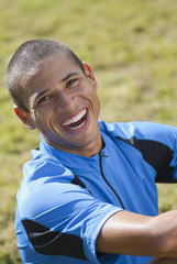 Smiling Hispanic athlete