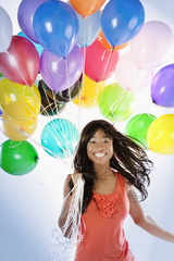 African American woman with birthday balloons