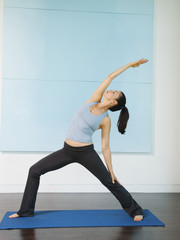 Mixed race woman practicing yoga