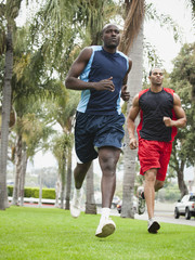 Men running in park together