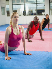 People in exercise class in health club