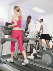 People exercising in health club