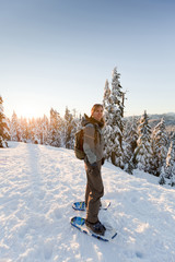 Caucasian woman snowshoeing in remote area
