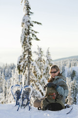 Caucasian woman snowshoeing in remote area taking break