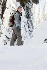 Caucasian woman walking in snow