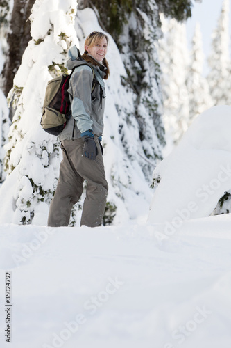 Caucasian woman walking in snow
