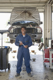 Mixed race mechanic working in auto repair shop