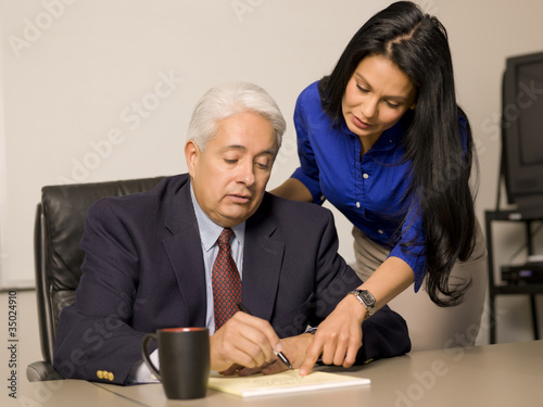 Business people reviewing paperwork together