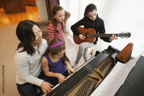 Students and teacher playing instruments