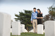 Couple visiting cemetery together