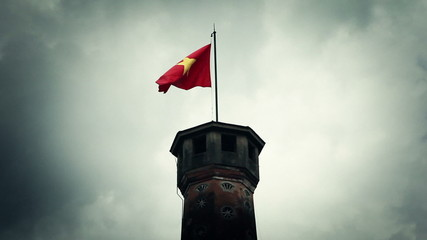 Waving vietnamese flag on top of high tower
