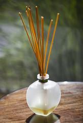 Sticks of incense in glass jar