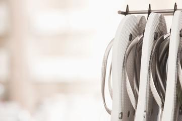 Close up of flip flops hanging on rack