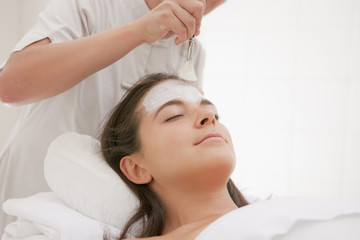 Woman having facial spa treatment