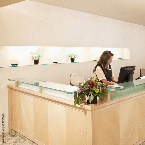 Woman working at spa resort desk