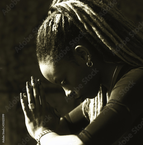 Serious woman praying