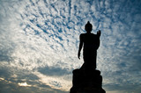 Standing buddha  image on beautiful blue sky