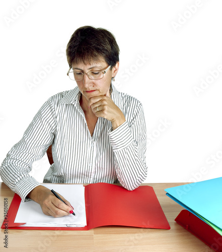 Older woman working at desk, administration