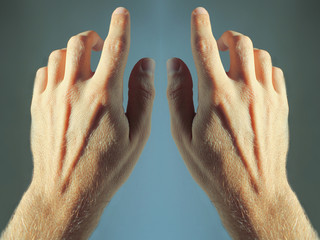 Two hands on blue background for web use