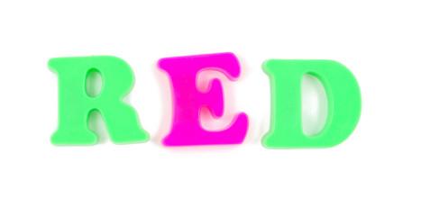 red written in child's fridge magnets on white