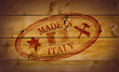 Made in Italy rubber stamp on wooden background