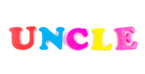 uncle written in fridge magnets on white background