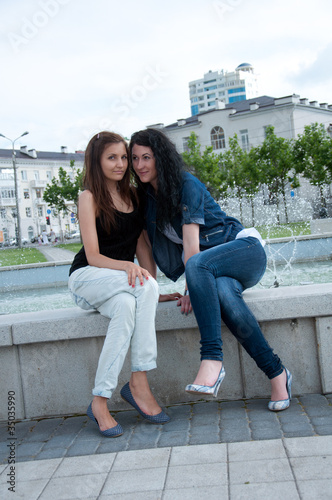 Two girls friends at city background