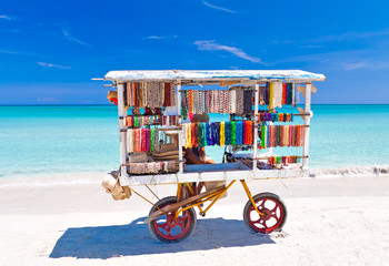 Cart selling typical souvenirs on cuban beach of Varadero