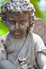 Old statue of an infant angel