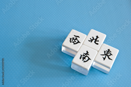 mahjong tiles of direction, east, south, west, north