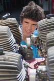 Hispanic teenager looking at engines