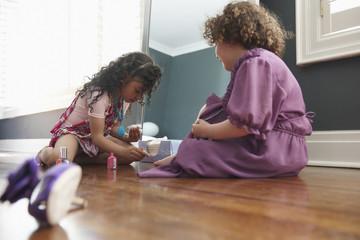 Girls painting their toenails