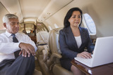 Business people working on private jet
