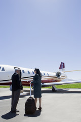 Business people boarding private jet