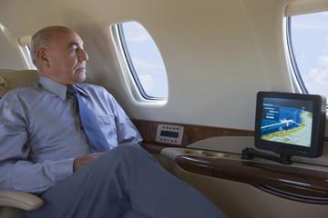 Hispanic businessman on private jet
