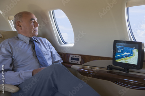 Hispanic businessman on private jet
