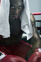 African American boxer relaxing after match