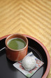 Japanese green Matcha tea and mochi sweet on tray
