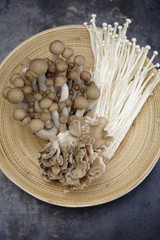 Variety of Asian mushrooms in basket