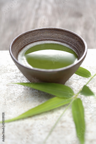 Close up of Japanese green Matcha tea and bamboo sprig