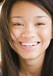 Close up of smiling mixed race teenage girl