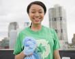 Smiling mixed race teenage girl wearing recycling t-shirt