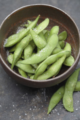 Close up of salted edamame in bowl