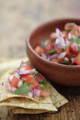 Salsa fresca in bowl and on tortilla chip