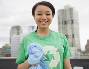Smiling mixed race teenage girl wearing recycling t-shirt