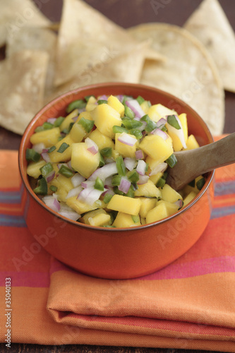 Close up of mango salsa and tortilla chips