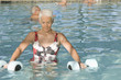 Caucasian woman exercising in swimming pool