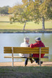Senior couple sitting on park bench
