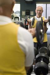 Caucasian man exercising in health club