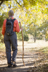 Caucasian woman hiking on path